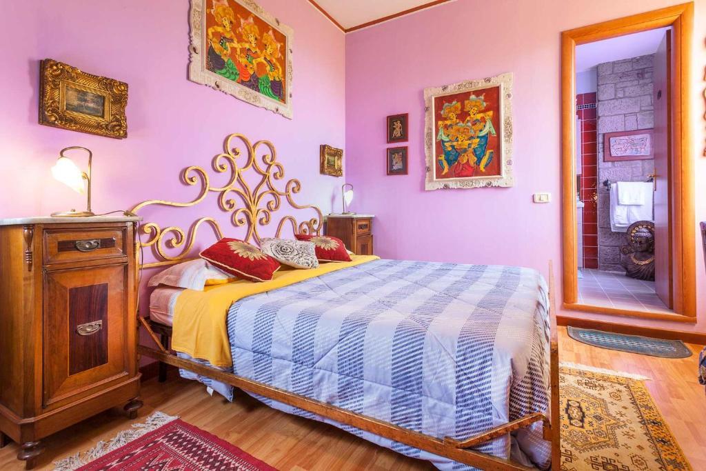Letto o letti in una camera di Casa Kita