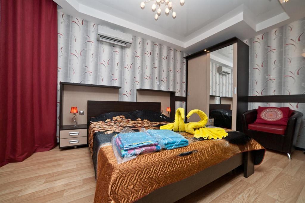 Кровать или кровати в номере Марьин Дом на Союзной, 2