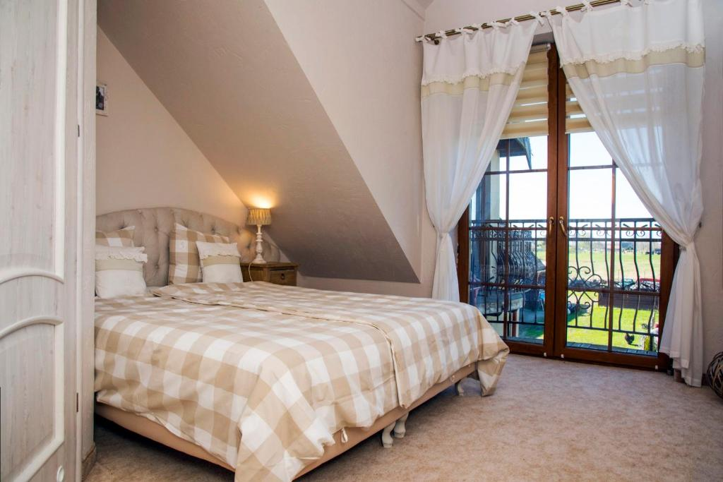 A bed or beds in a room at Feniks Agro&Spa Adults Only