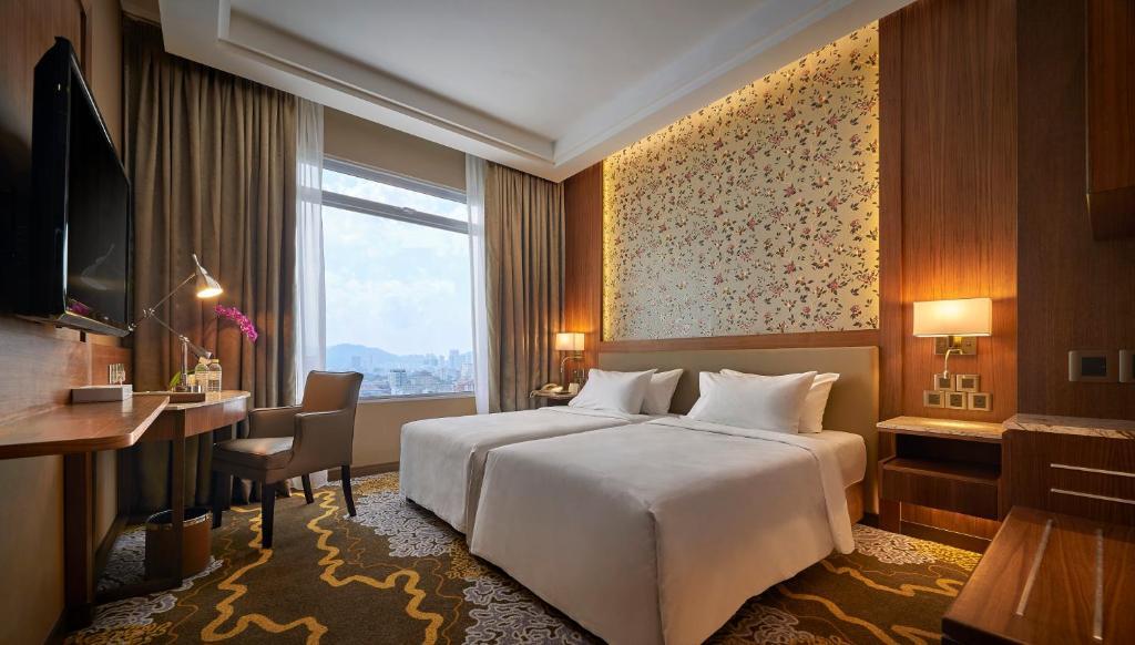 Ein Bett oder Betten in einem Zimmer der Unterkunft The Wembley – A St Giles Hotel, Penang
