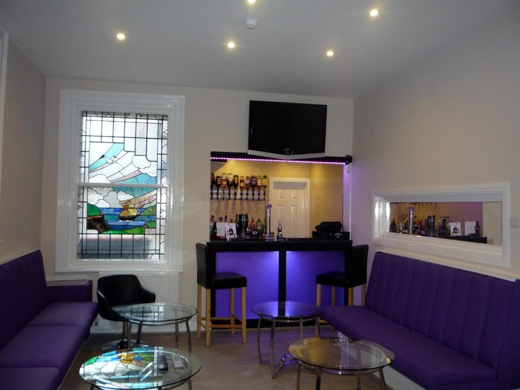 The lounge or bar area at Rosebank Villa