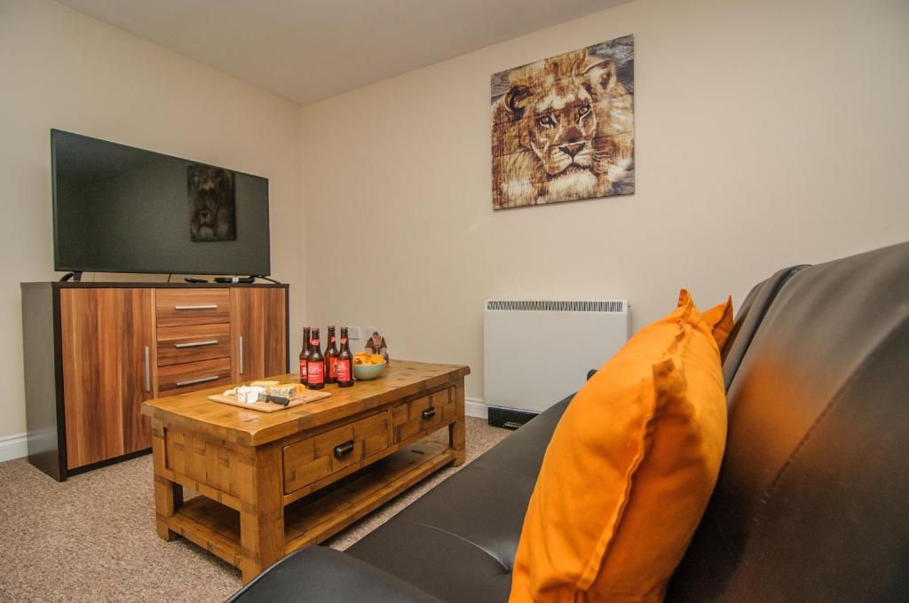 A television and/or entertainment center at Sargeson Apartment