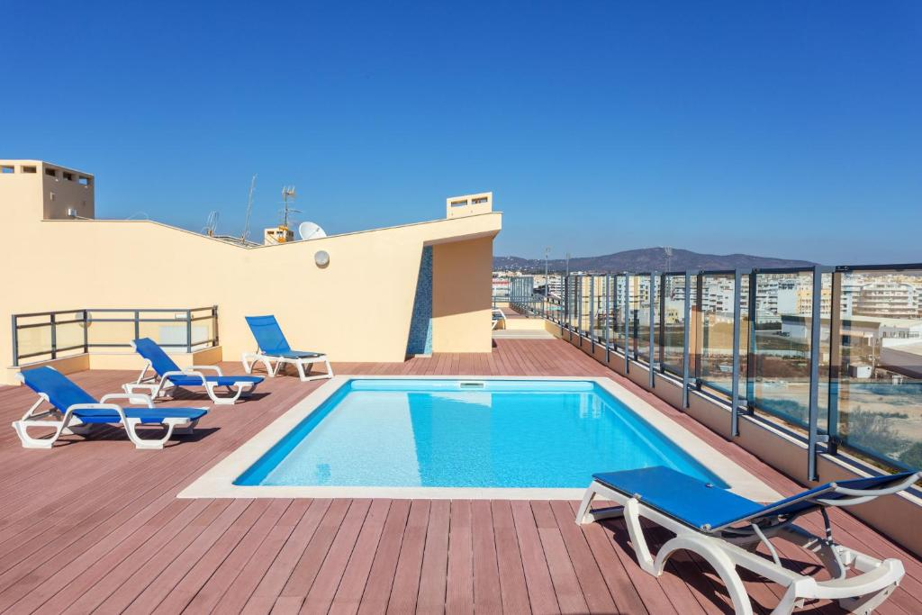 The swimming pool at or near Appartement de Charme