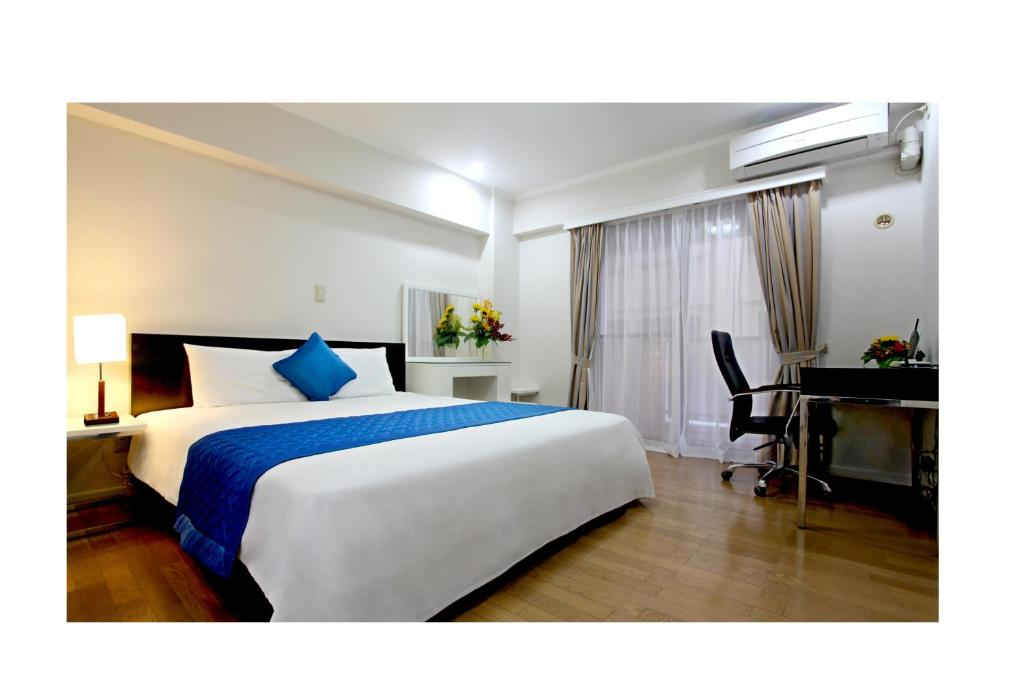 A bed or beds in a room at Saigon Sky Garden Serviced Apartments