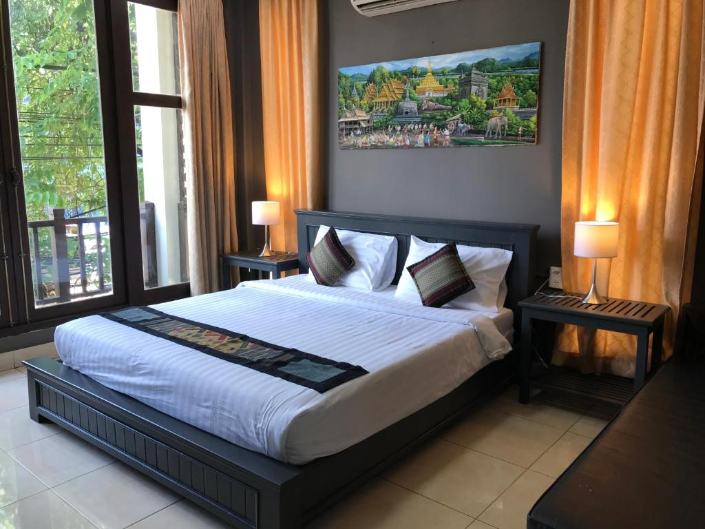 A bed or beds in a room at VKS Hotel