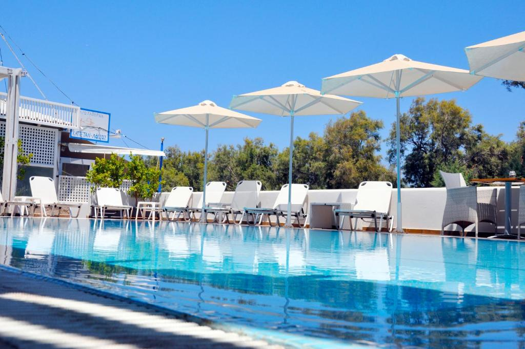 The swimming pool at or near Memories Beach Hotel