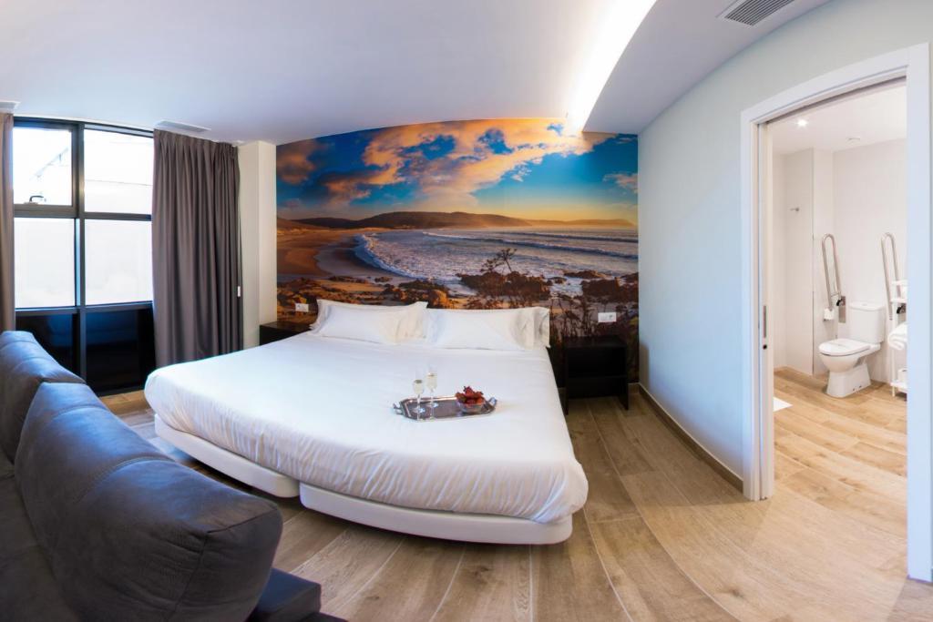 A bed or beds in a room at Playacruz Apartamentos