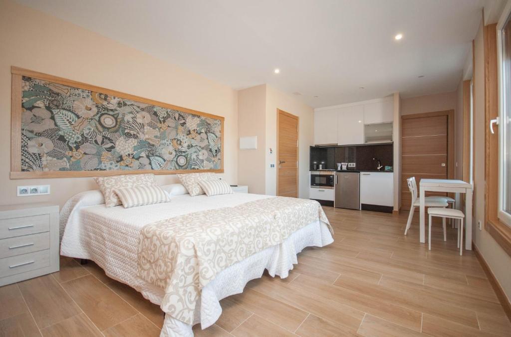 A bed or beds in a room at Casa Chelo Alojamientos Turisticos