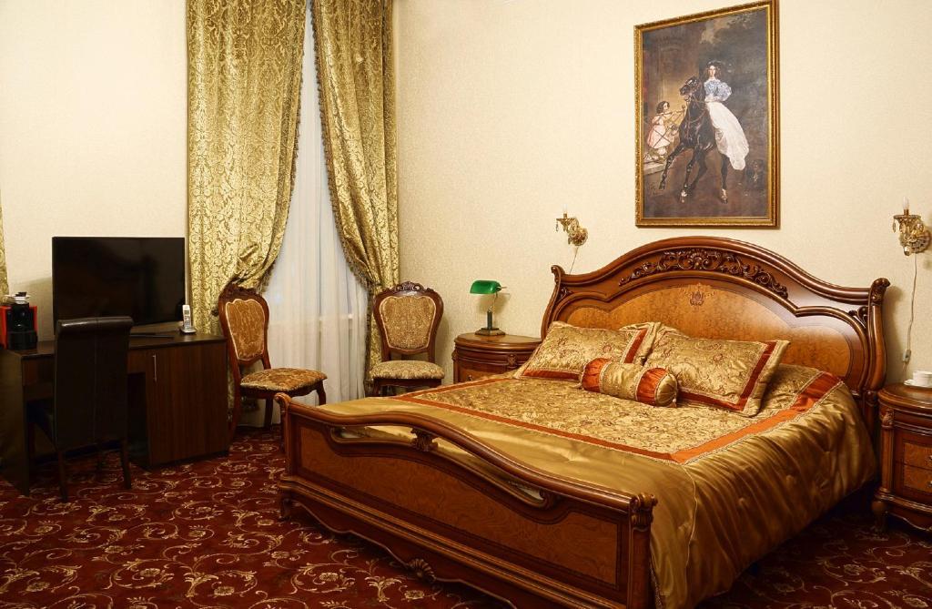 Кровать или кровати в номере Камергерский