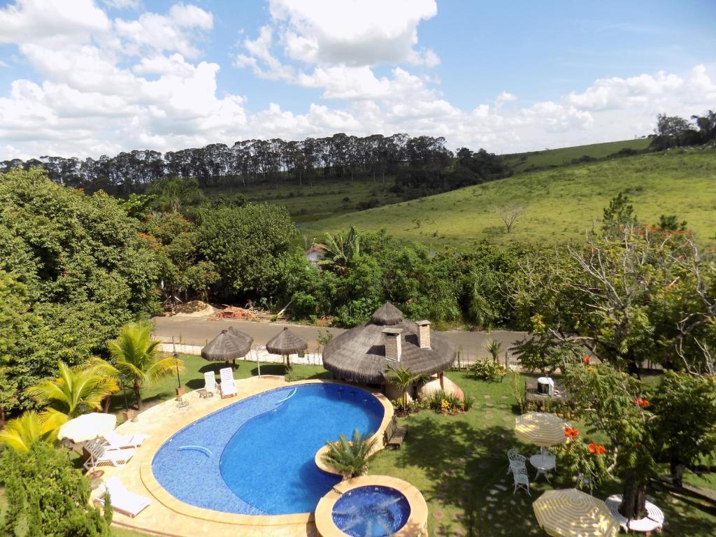 Uma vista da piscina em Pousada Rural Paraíso ou nos arredores