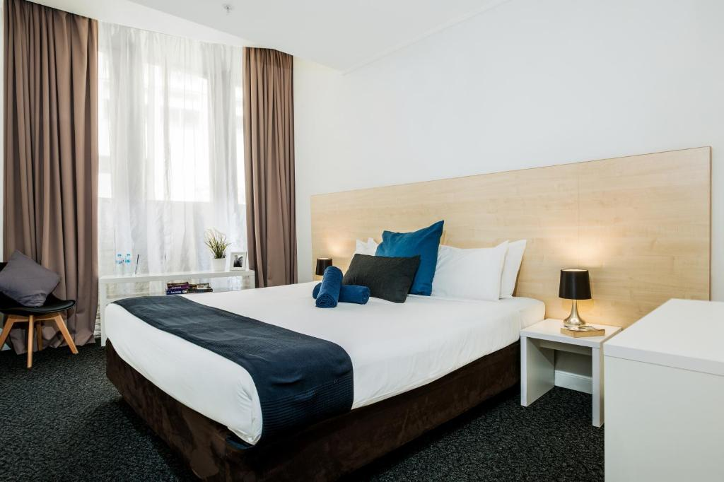 A bed or beds in a room at Base Sydney