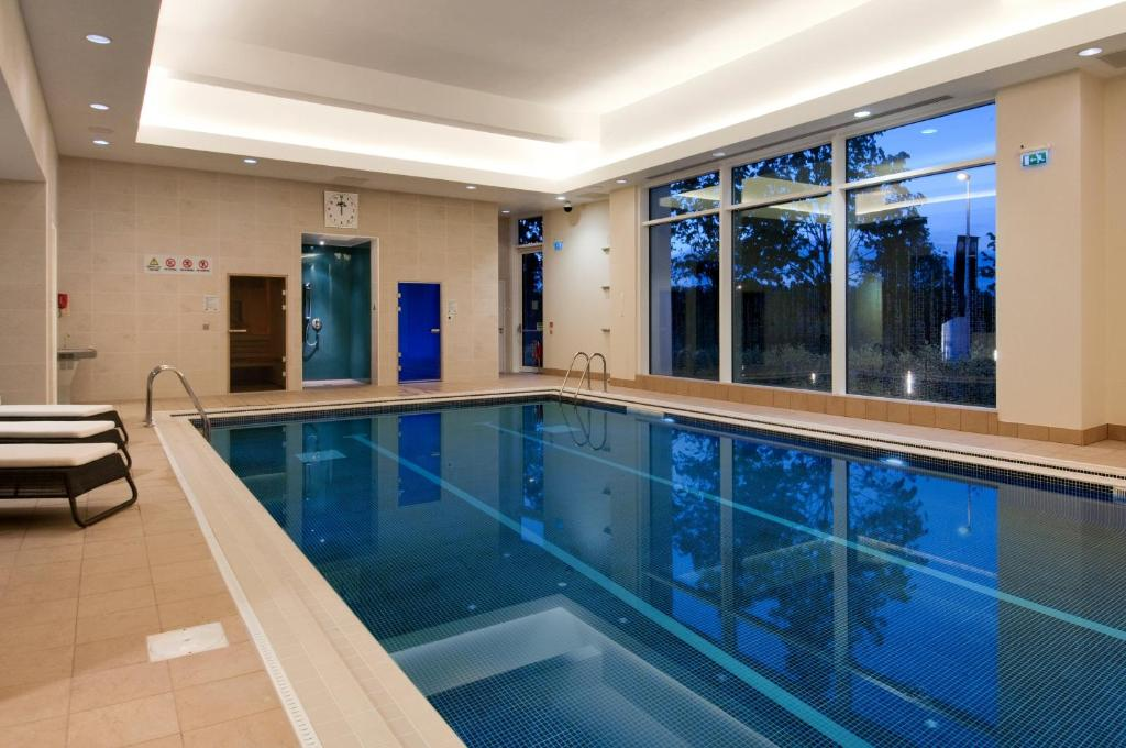 The swimming pool at or near Hilton Reading