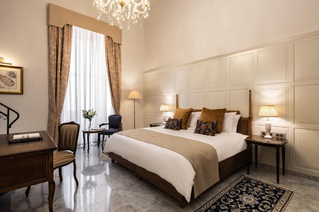 Un ou plusieurs lits dans un hébergement de l'établissement Palais Le Brun