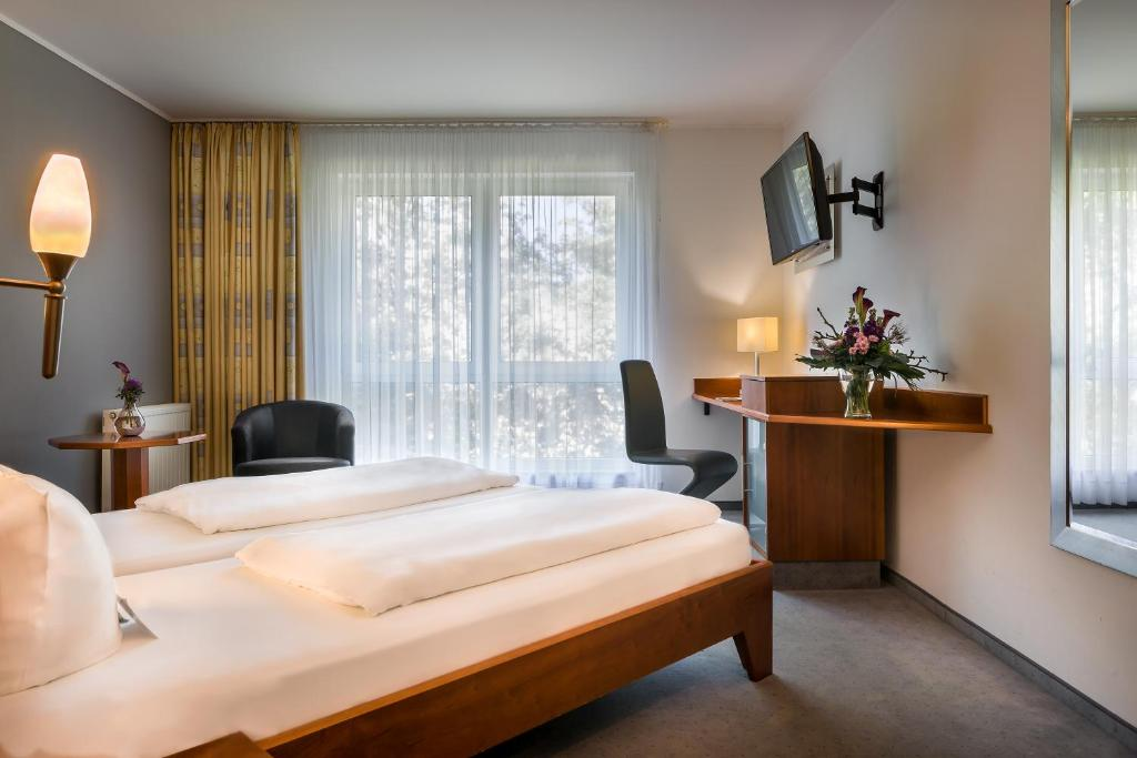 A bed or beds in a room at Select Hotel am Centro Oberhausen