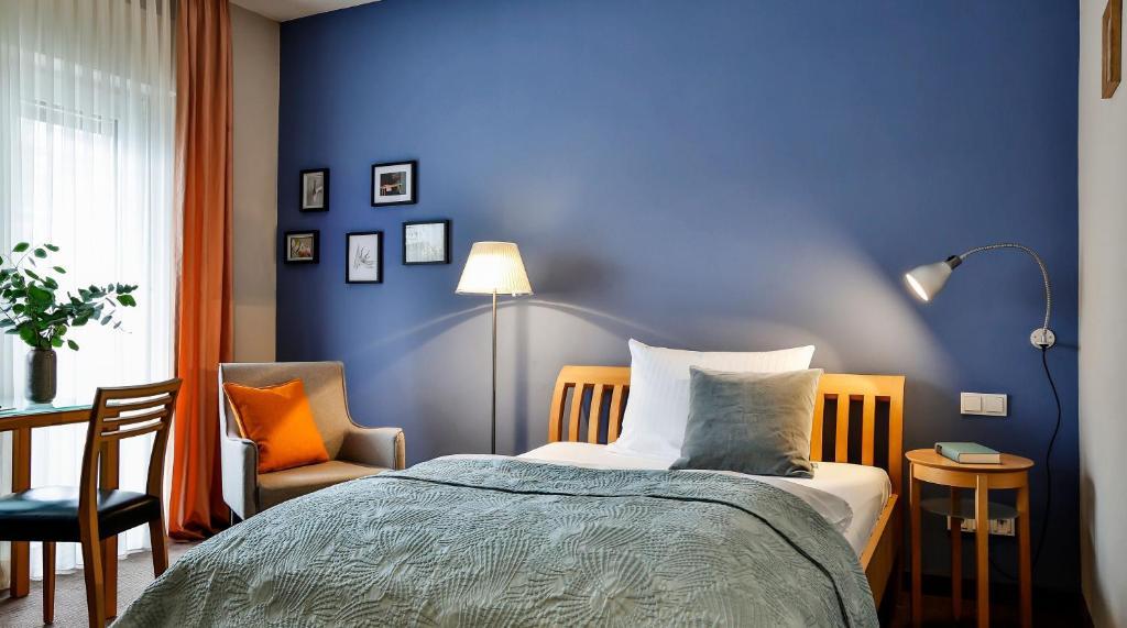 A bed or beds in a room at BIO-Hotel Villa Orange