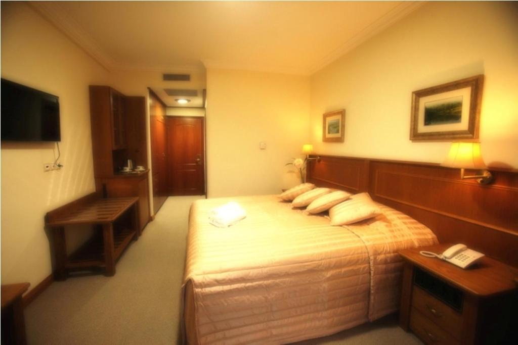 Ένα ή περισσότερα κρεβάτια σε δωμάτιο στο Afkos Grammos Boutique Hotel Resort
