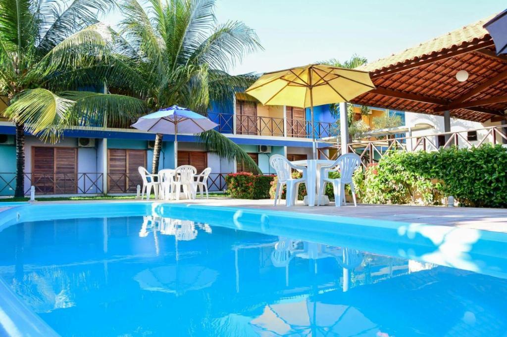 A piscina localizada em Pousada Solar da Praia ou nos arredores