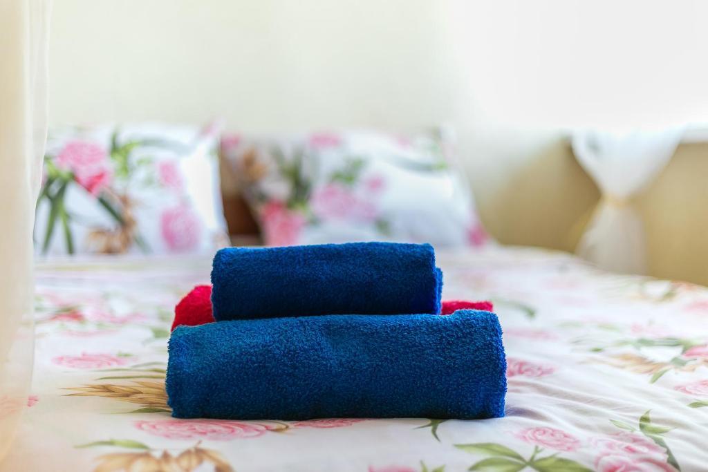 Кровать или кровати в номере Apartments Leningradskiy prospekt