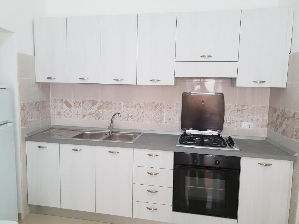 A kitchen or kitchenette at Lifra1