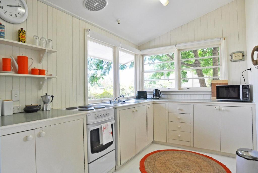 A kitchen or kitchenette at SEA WHISPERS - INLET SIDE