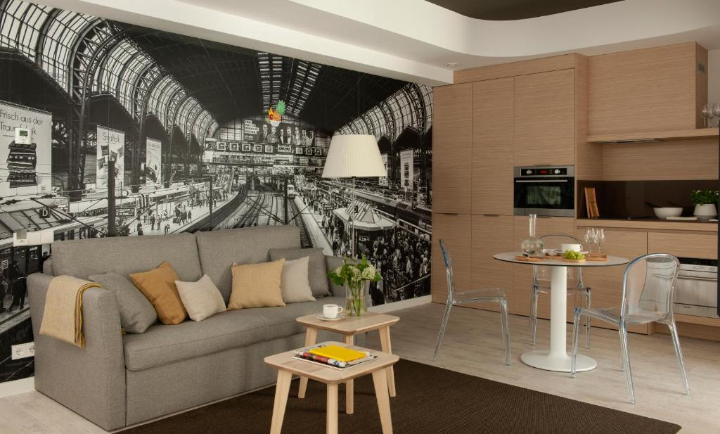 A seating area at Eric Vökel Boutique Apartments - Hamburg Suites