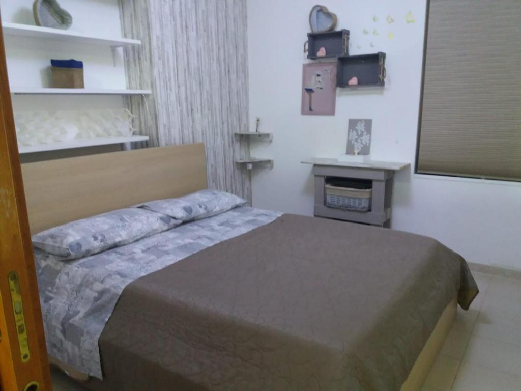 A bed or beds in a room at La Casetta