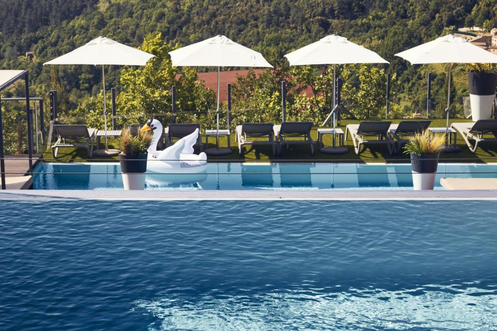 The swimming pool at or near Domaine de Chalvêches Hôtel SPA 4*