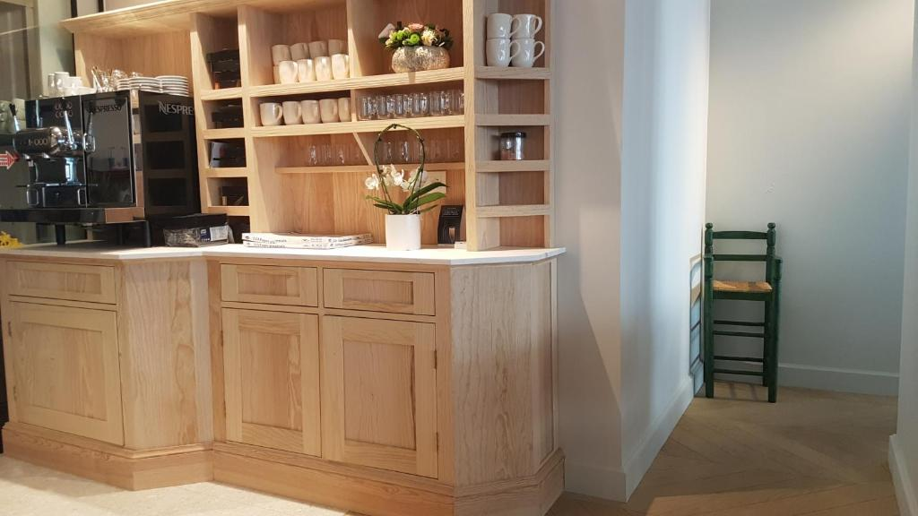 De lobby of receptie bij Rewindhotel