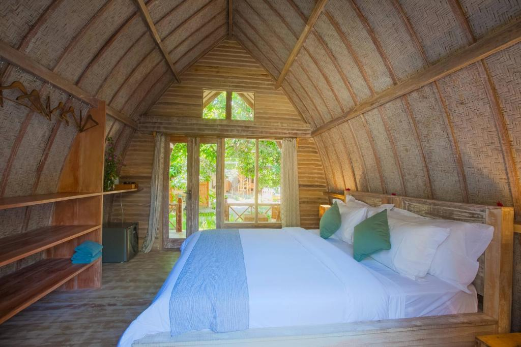 A bed or beds in a room at Flowers & Fire Yoga Garden