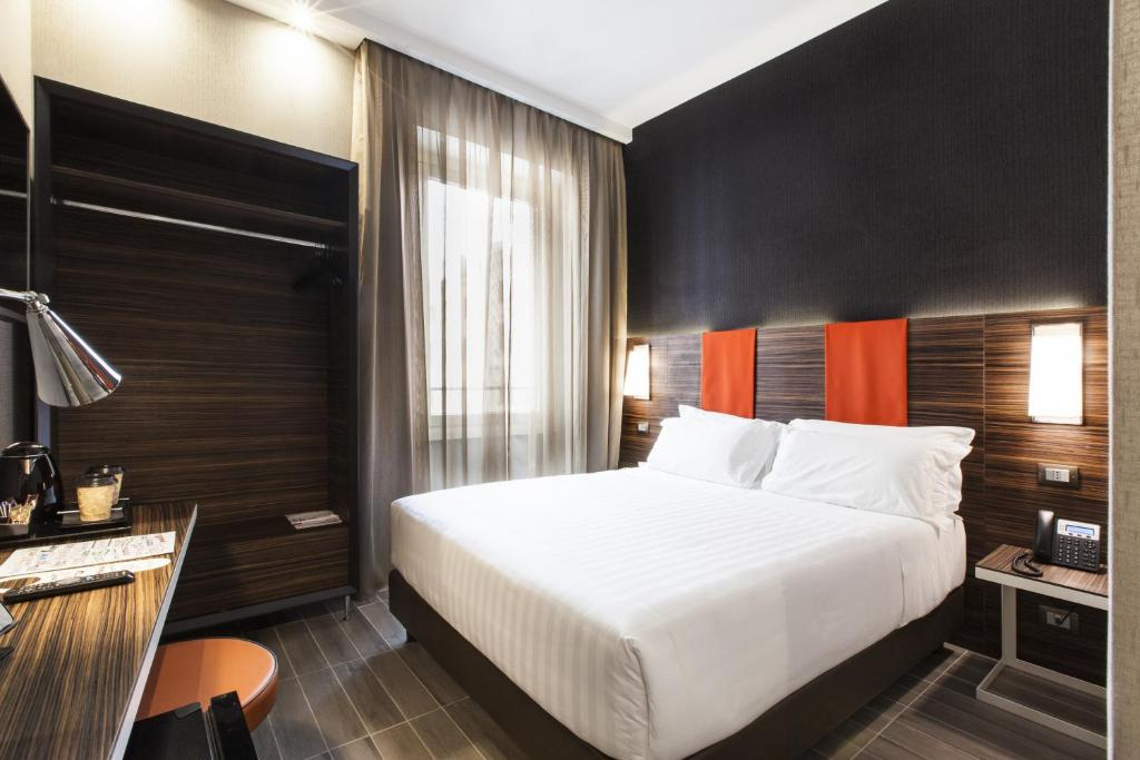 A bed or beds in a room at The Republic