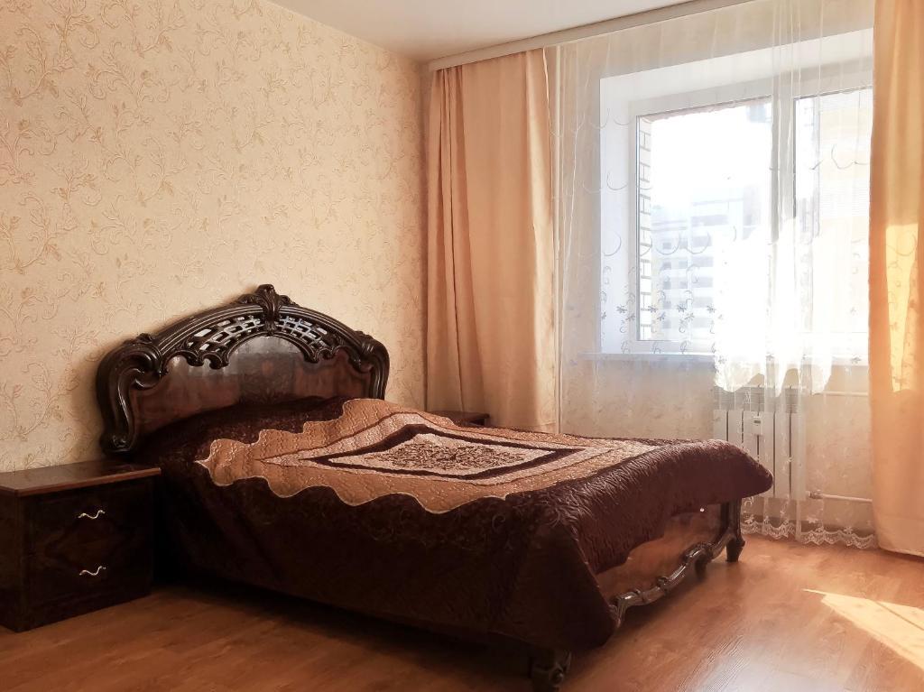 Кровать или кровати в номере Apartment on Magistralnaya