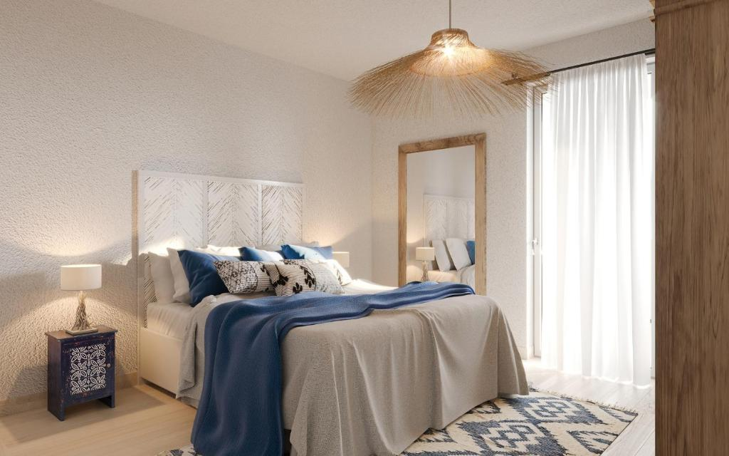 A bed or beds in a room at Residence Mar Mediterraneo