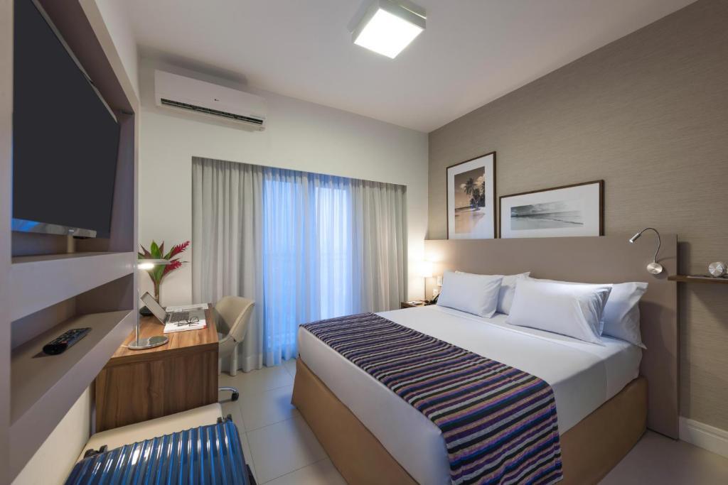 Cama ou camas em um quarto em Matiz Multi Suites