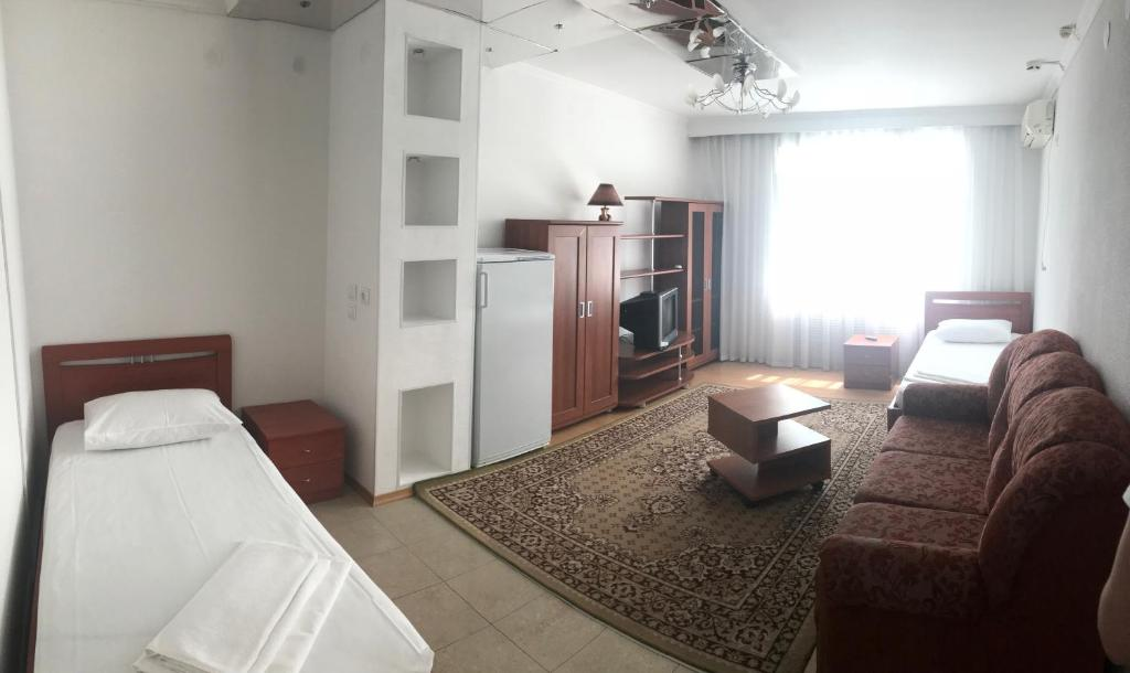 A bed or beds in a room at Airoport Hotel Anapa