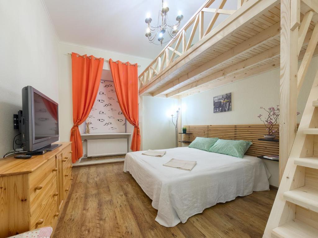 Кровать или кровати в номере Heart of the City Townhouse