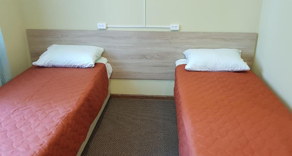 Кровать или кровати в номере OMZ Hotel