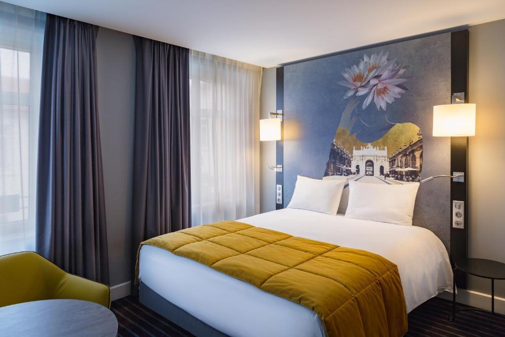 Un ou plusieurs lits dans un hébergement de l'établissement Mercure Nancy Centre Place Stanislas (Plats Maison disponible)