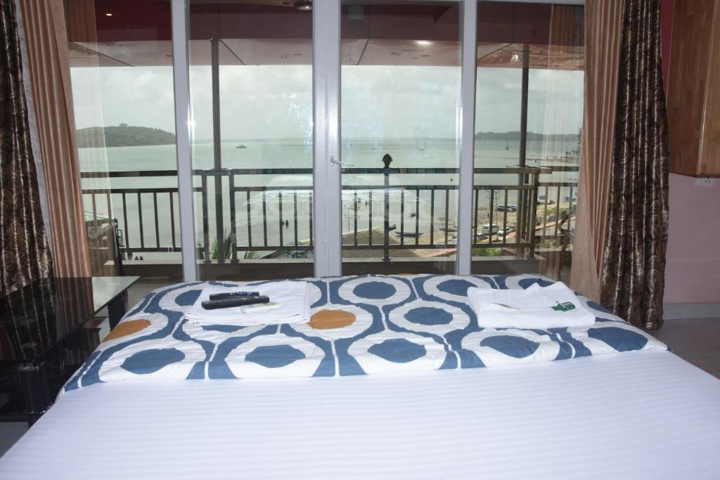 A bed or beds in a room at The Seaview Residency