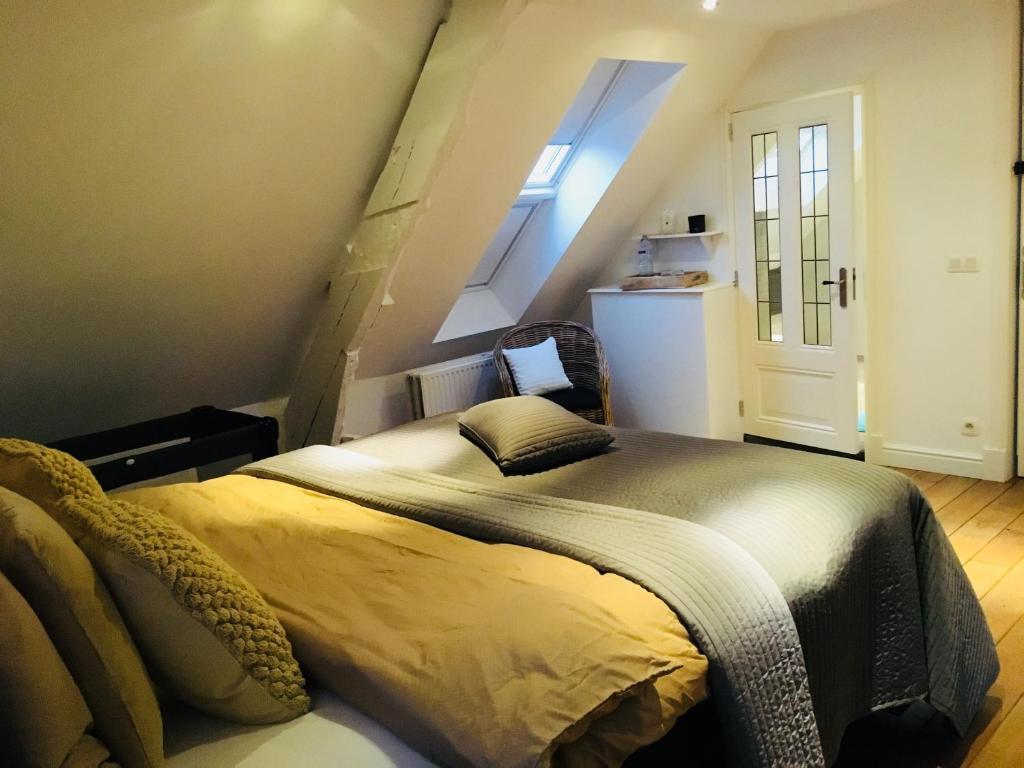 Een bed of bedden in een kamer bij b&b maison innoa