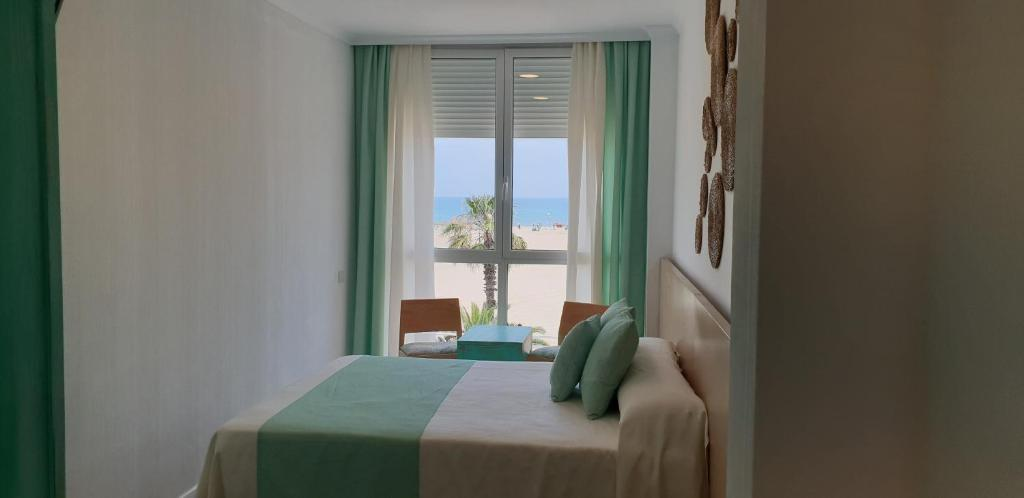 Cama o camas de una habitación en El Globo