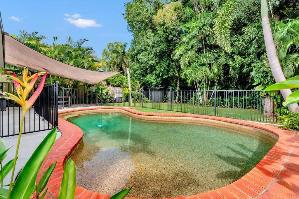 The swimming pool at or near Coral Sea Holiday House