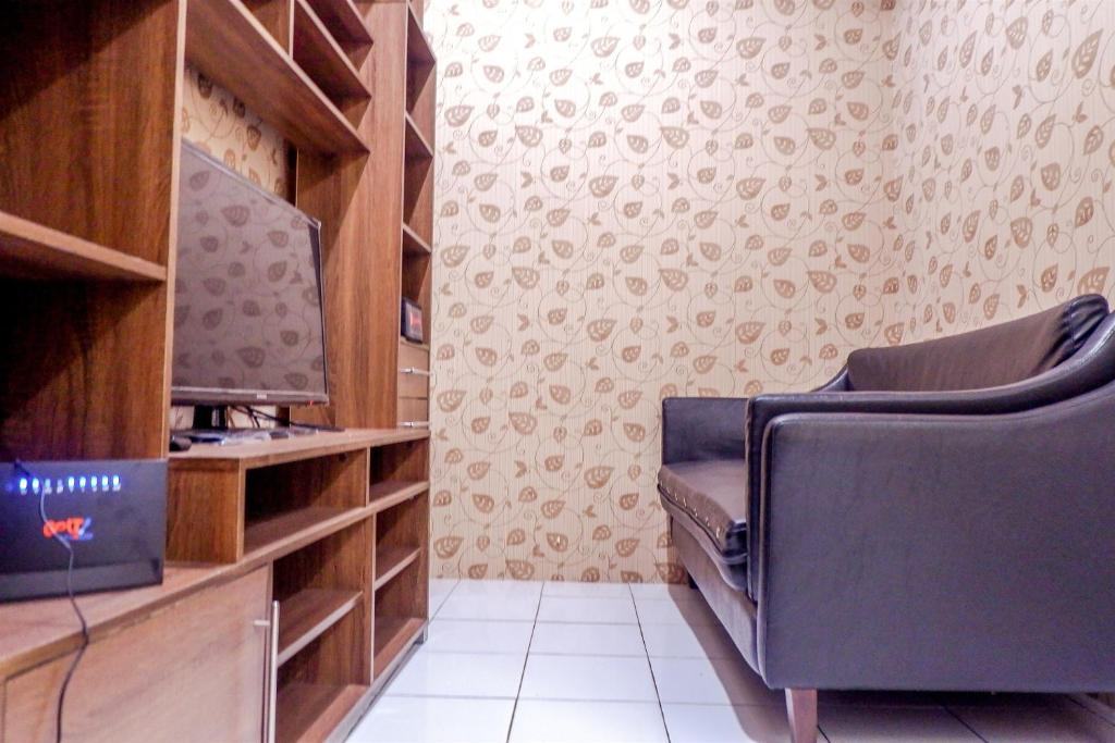 A television and/or entertainment center at Strategic 2BR Menteng Square Apartment By Travelio