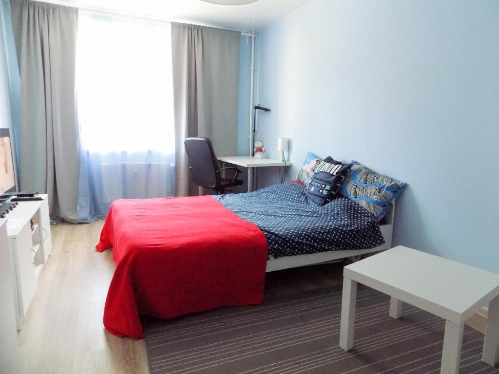 Кровать или кровати в номере Go Apartment Балтийская
