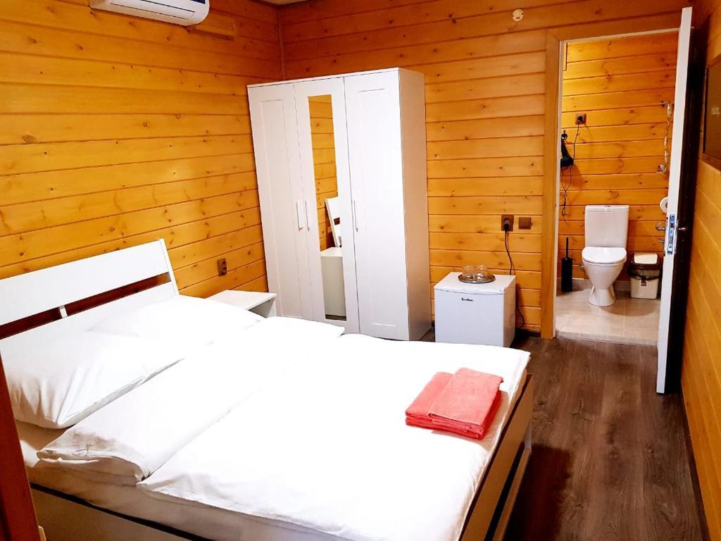 Кровать или кровати в номере Гостевой дом «Amore Sea»