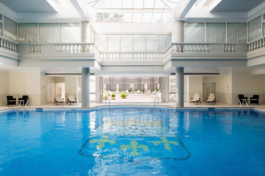 The swimming pool at or near Waldorf Astoria Versailles - Trianon Palace