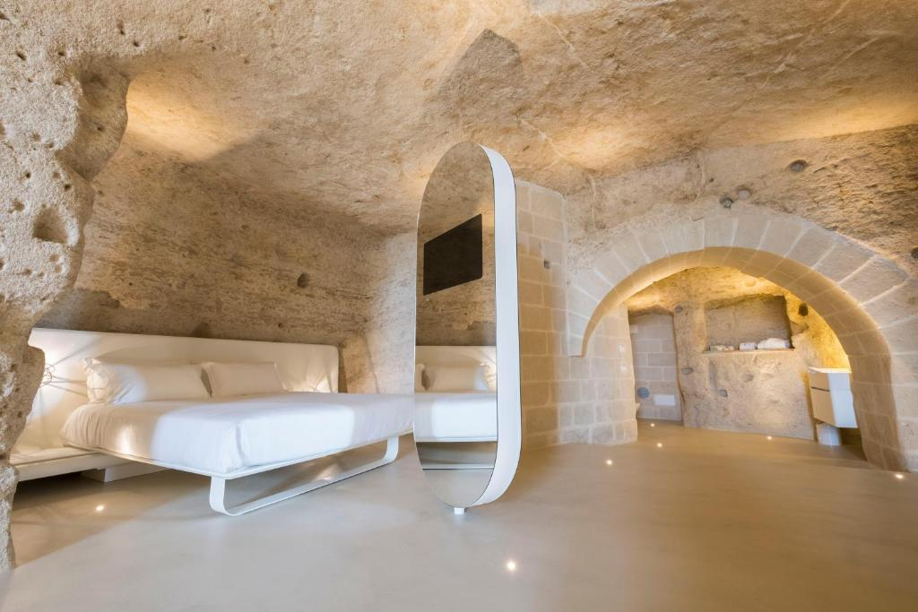 A bed or beds in a room at Aquatio Cave Luxury Hotel & SPA