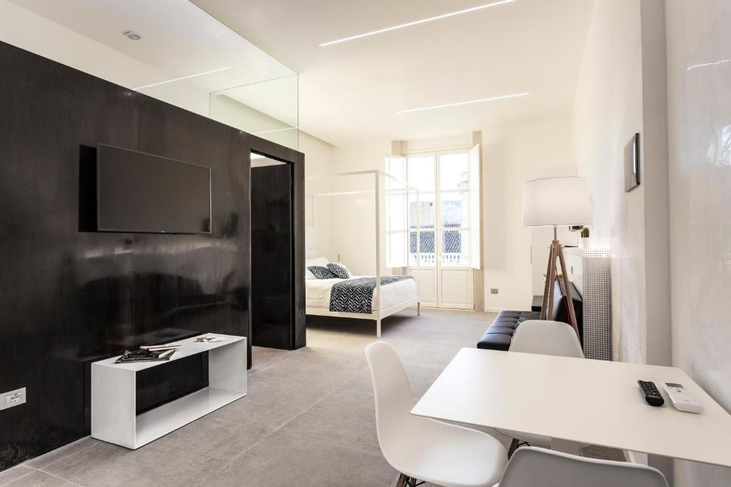 TV o dispositivi per l'intrattenimento presso Nostos rooms & Apartments
