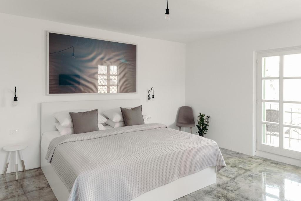 A bed or beds in a room at Art Hotel Tartini