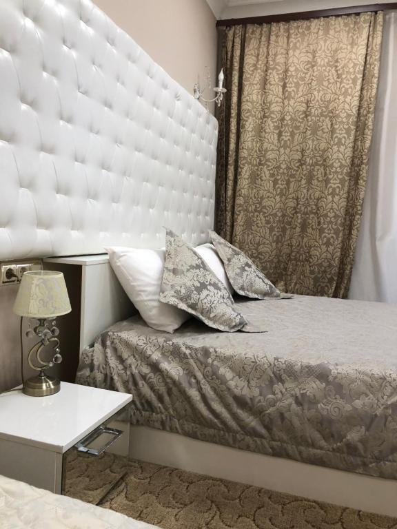 Кровать или кровати в номере Бутик Отель Дворянское Гнездо