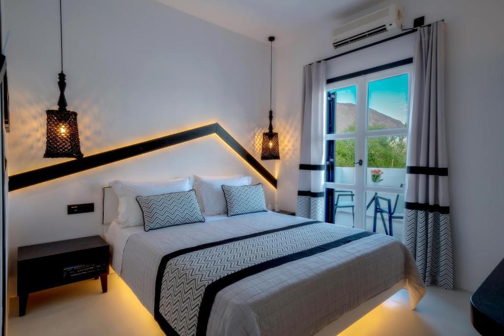 Letto o letti in una camera di Divelia Hotel